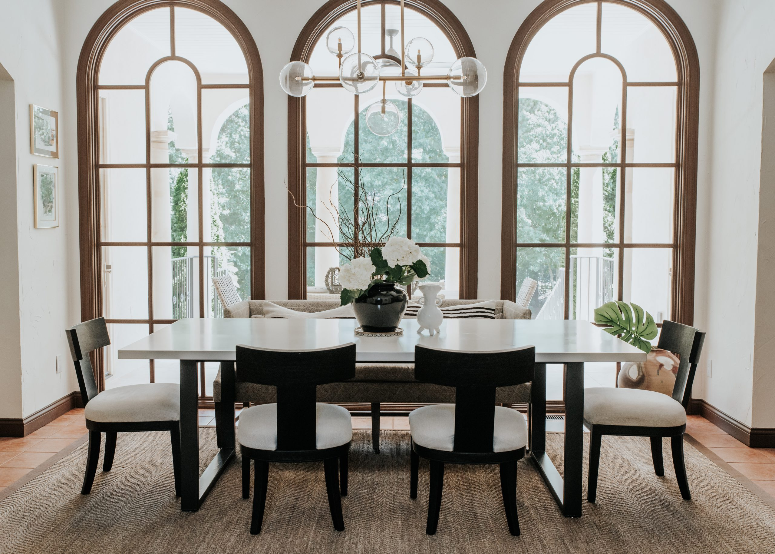 braylon square dining table in front of the windows